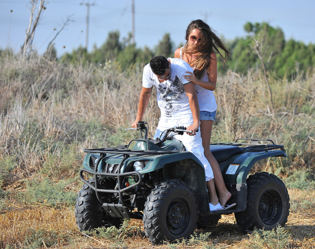 **Exclusive to Reveal Magazine. 1st Uk Rights** Peter Andre and new girlfriend Emily McDonaugh on holiday in Cyprus - the pair looked to be having a great time as they drove a quadbike Cyprus - 06.08.12 Mandatory Credit: WENN.com