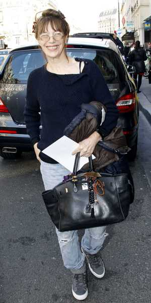 Jane Birkin carrying a Hermes Birkin handbag