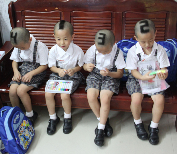 Mother has numbers shaved into hair of quadruplet sons, Shenzhen, Guangdong Province, China - 03 Sep 2012