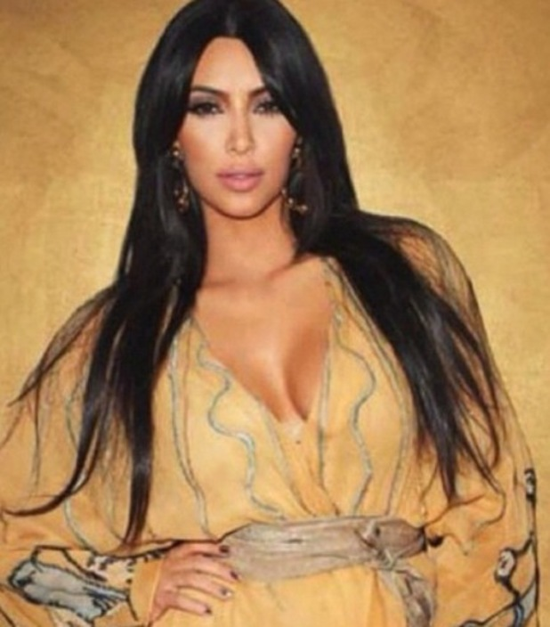 Kim Kardashian wears a robe lent to her by the late Elizabeth Taylor