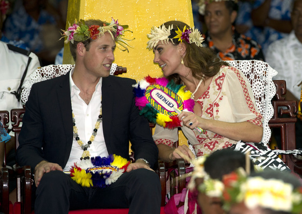 The Duke and Duchess of Cambridge look on as locals dance at Vaiaku Falekaupule during a visit to Tuvalu, Solomon Islands, during a nine-day royal tour of the Far East and South Pacific in honour of the Queen's Diamond Jubilee. Picture date: Tuesday September 18, 2012. See PA story ROYAL Jubilee. Photo credit should read: Arthur Edwards/The Sun/PA Wire