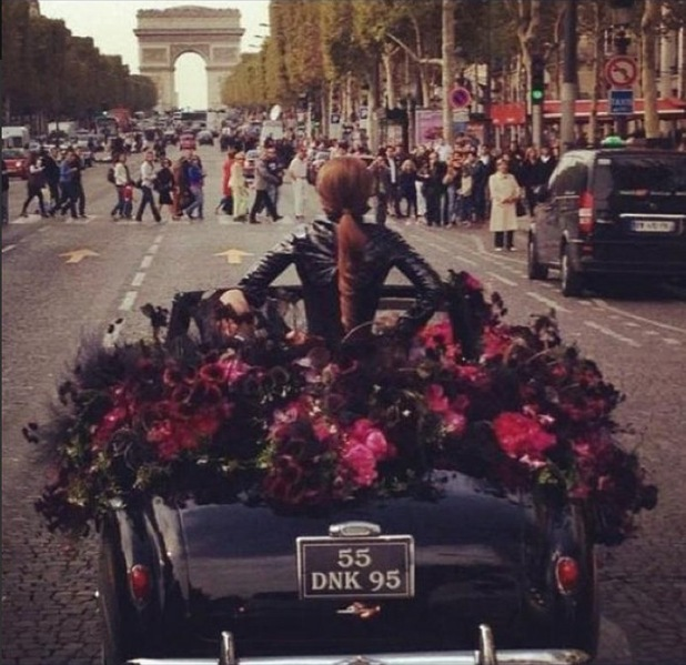 Lady Gaga driving to her perfume launch in Paris on Sunday, 23 September.