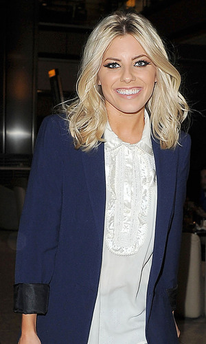 miss mode: Mollie King arrives at Heathrow airport with the rest of her band mates from The Saturdays on a flight from Glasgow. London, England - 20.05.12 Mandatory Credit: Will Alexander/WENN.com