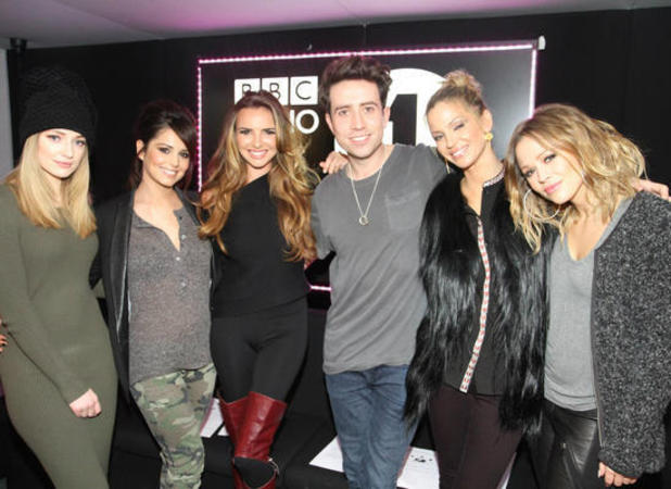 Miss Mode: Girls Aloud and Nick Grimshaw pose at Radio 1 studios