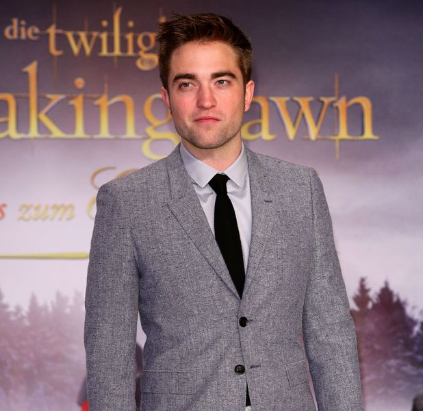 Robert Pattinson alone, at Breaking Dawn Premiere