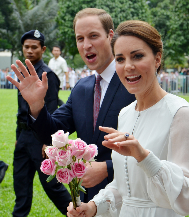 Britain's Prince William and his wife Kate, the Duke and Duchess of Cambridge wave to the public during a walk through a central city park in Kuala Lumpur, Malaysia, Friday, Sept. 14, 2012. Prince William and Kate are in Malaysia for a three-day visit as part of a tour to mark Queen Elizabeth II's Diamond Jubilee. (AP Photo/Margaret Maxwell)