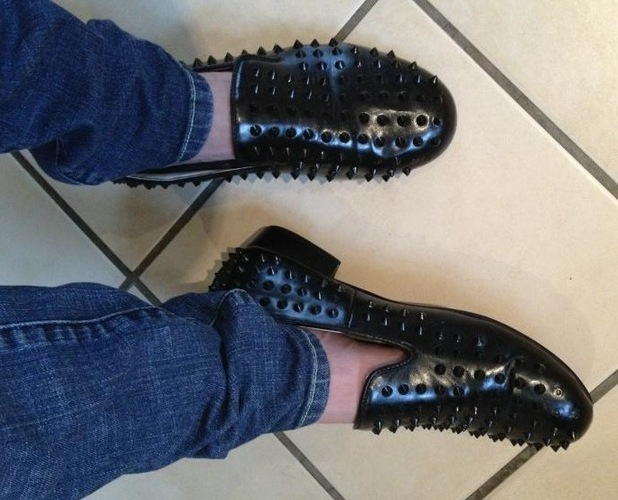 Harry Derbidge shows off his spiked shoes