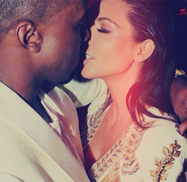 Kim Kardashian and rapper Kanye West share a kiss on the red carpet at the Cannes Film Festival 2012.