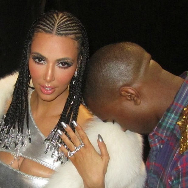 Kim Kardashian cosies up to Kanye in throwback from music ...