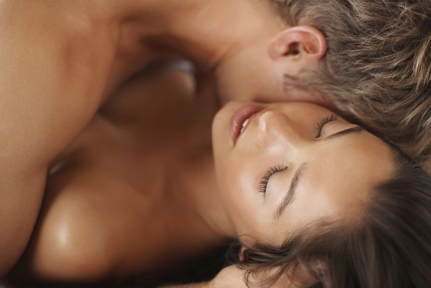 Couple kissing in bed naked for use with erotic fiction extract