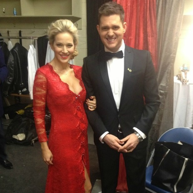 Michael Bublé and pregnant wife Luisana Lopilato on the way to the red carpet for the JUNO Awards.