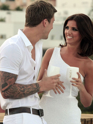 Lucy Mecklenburgh and Dan Osborne drinking in Marbella, 28th May 2013. REVEAL USE ONLY.