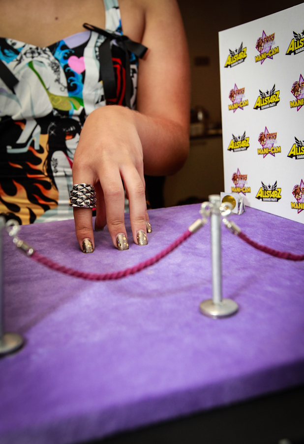 Amelia Lily enjoys Foxy BIngo's Mani-cam at the Allstarz party to celebrate the launch of Foxy's Fur Her nail wraps, 1 June 2013