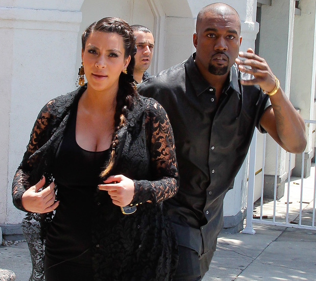 Kim Kardashian and Kanye West are seen house hunting in Beverly Hills. Kanye lashes out on the paparazzi after banging his head with the metal street sign - 10 May 2013