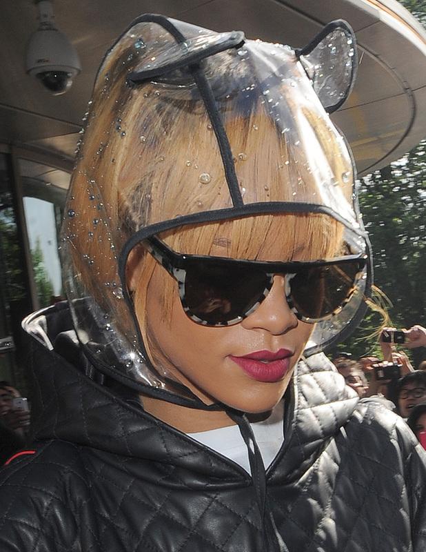 Rihanna leaving her London hotel wearing a crazy waterproof hat with cat ears, June 15 2013