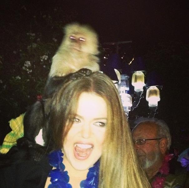 Khloe Kardashian poses with a monkey - 8 June