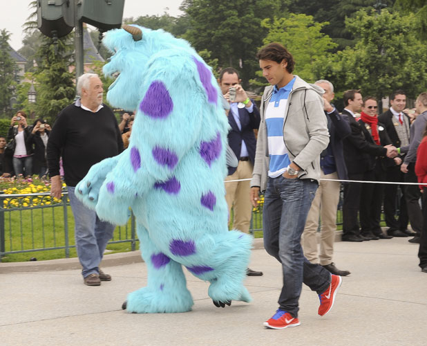Rafael Nadal celebrates his win at the French Open with a visit to Disneyland Paris, 10 June 2013