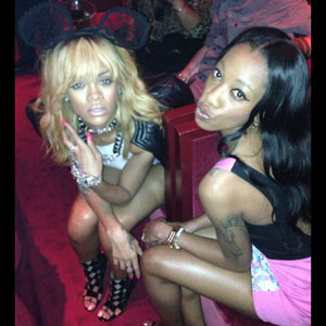 Rihanna poses with a friend in Paris