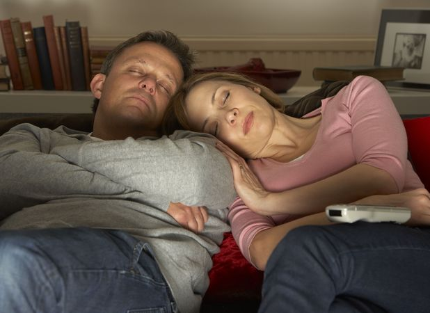 couple asleep in front of TV