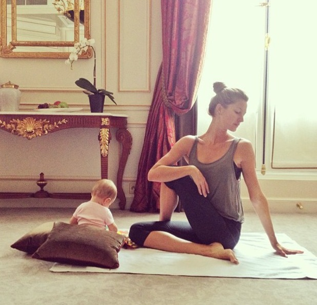 Gisele Bundchen poses with daughter Vivian during yoga practise - June 19 2013