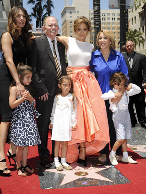 Jennifer Lopez poses with her family as she is honoured with the 2,500th star on the Hollywood Walk of Fame, 20 June 2013