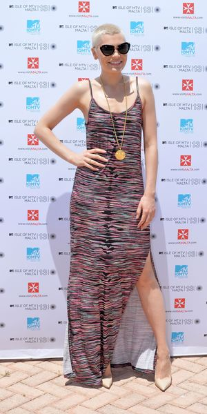 Jessie J poses in the sunshine at the Isle of MTV press conference wearing a thigh split maxi dress and sunglasses - Valletta, Malta, 26 June 2013