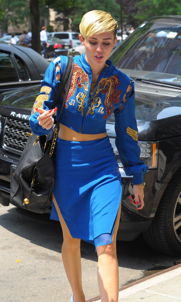 Miley Cyrus in Tribeca wearing a blue cropped bomber jacket and pencil skirt - New York 27 June 2013