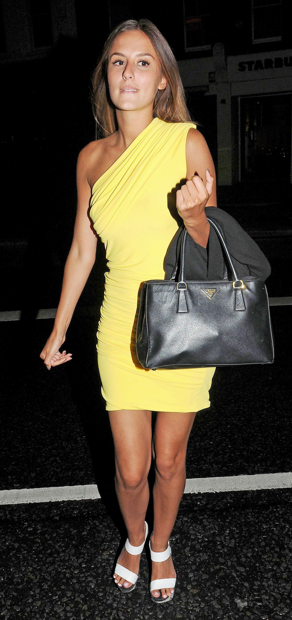 Lucy Watson wears a canary yellow one shoulder dress for a date with Jordan Turner Hall at the Eight Over Eight restaurant - London 28 2013