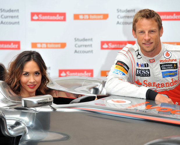Myleene Klass and Jenson Button pose for pictures with a McClaren Formula One car to promote the car manufacturer's sponsorship with Santander - photocall held at the British Medical Association