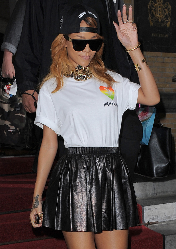 """Rihanna leaving her hotel, to perform for the second night at the Ziggo Dome, as part of her Diamonds World Tour. Rihanna was wearing a T-shirt with the words """"High Fashion"""" written underneath a logo featuring a cannabis leaf - 25 June 2013"""