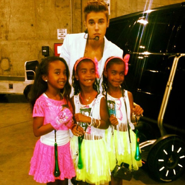 Justin Bieber with Diddy's kids at his concert, 25 June 2013