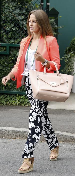 Kim Sears at Wimbledon wearing an orange blazer and black and white trousers - London 3 July 2013