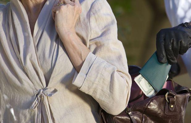 Stock image of man stealing handbag