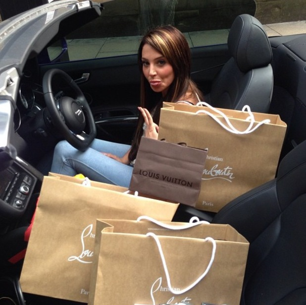 Tulisa pictured surrounded by designer bags - July 1 2013