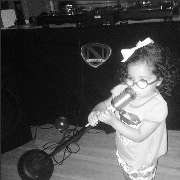 Mariah Carey's daughter Monroe imitates her mother by singing into a mic