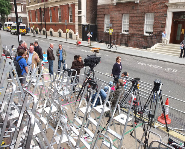 Members of the media start to set up their ladders and tripods outside The Lindo Wing of Saint Mary's Hospital in Paddington, west London, where Catherine, Duchess of Cambridge will give birth