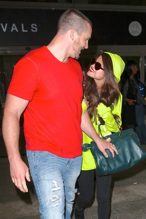 Selena Gomez arrives at LAX Airport accompanied by her step father Brian Teefey - 10 July 2013