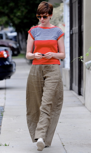 Anne Hathaway was all smiles while walking to a friends house wearing big baggy trousers and a fedora hat - 10 July 2013