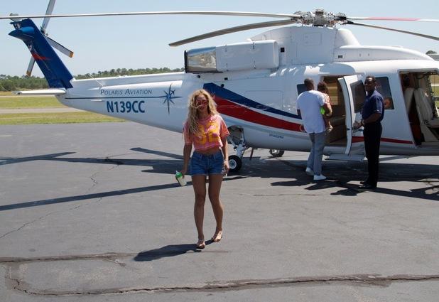 Beyoncé, Blue Ivy, Jay-Z boarding a helicopter- July 2013