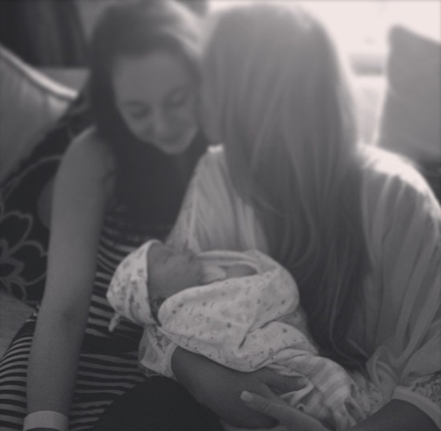 Lauren Goodger poses with her new nephew and sister Rianna - July 2013