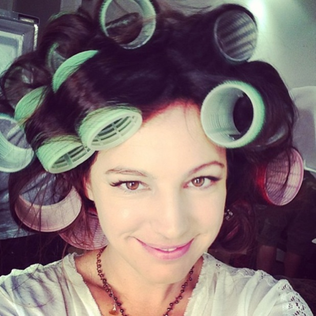 Kelly Brook Instagrams a picture of herself having hair done in Velcro rollers, 9 July 2013
