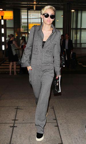 Miley Cyrus at Heathrow Airport, London, Britain - 17 Jul 2013
