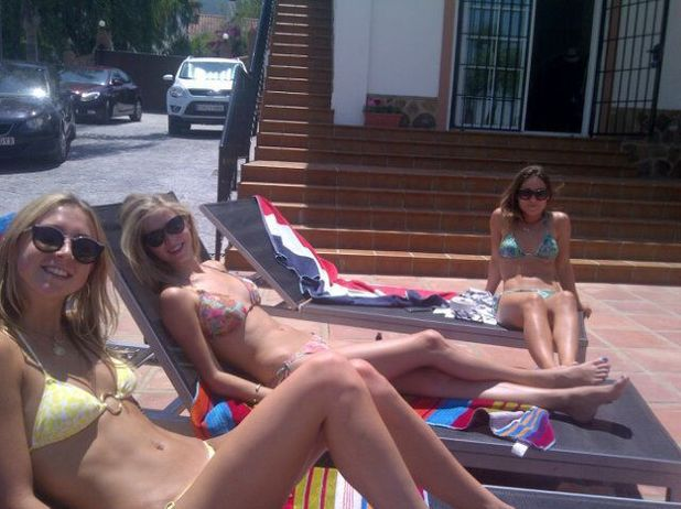Louise Thompson tanning in Spain - July 2013