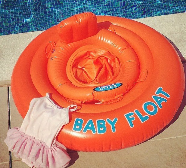 Rochelle Humes posts picture of daughter's swimsuit and baby float on holiday in Portugal - July 2013