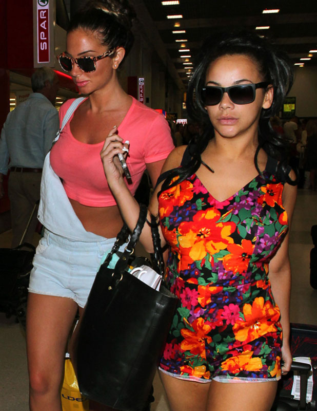 Tulisa Contostavlos and Chelsee Healy arriving at Manchester Airport after a holiday in Ibiza, 16 July 2013