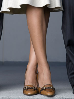 MODEL RELEASED, Close up of three business colleagues' feet