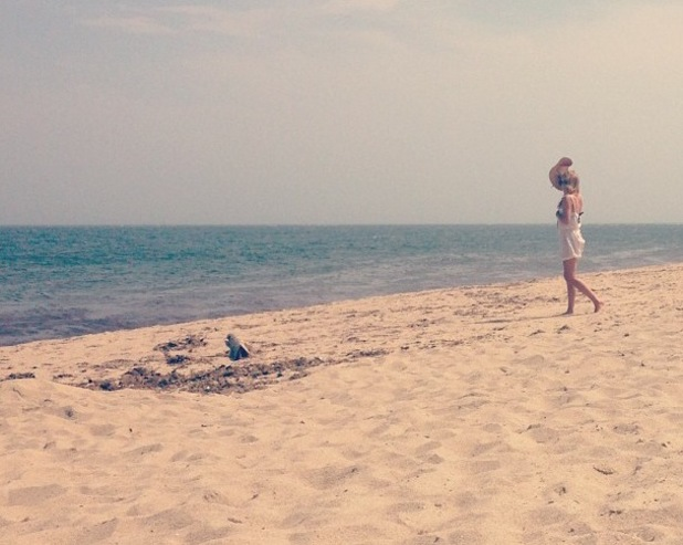 Lauren Conrad relaxes on the beach - 24 July 2013