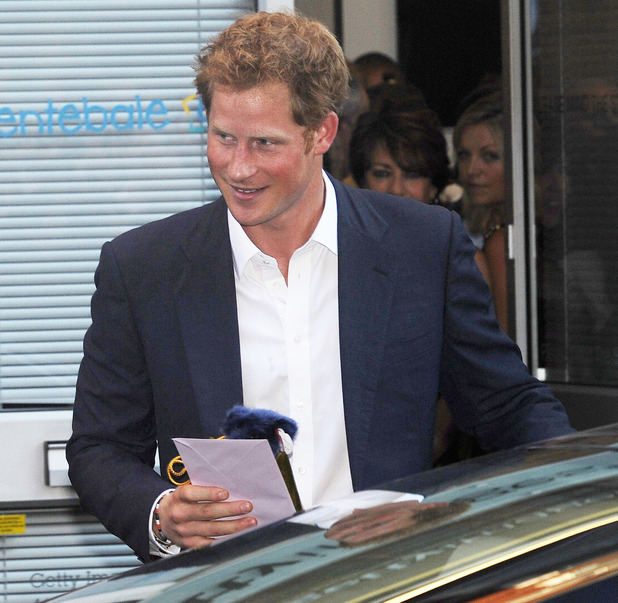 Prince Harry leaves Getty Images Gallery in London and was given a present by a fan for his new nephew Prince George. - 25 July 2013