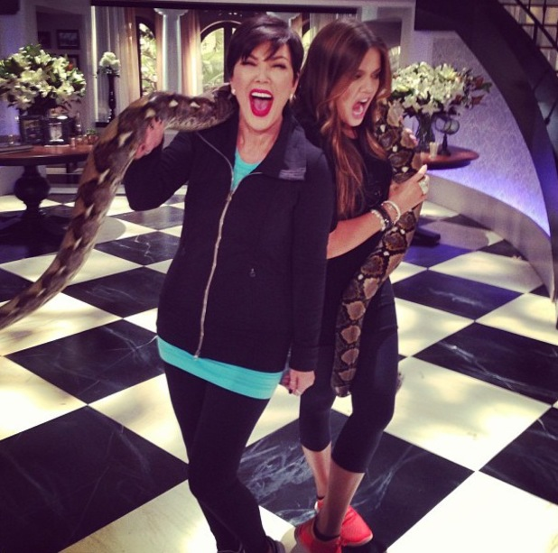 Kris Jenner and Khloe Kardashian pose with giant python on Kris talk show