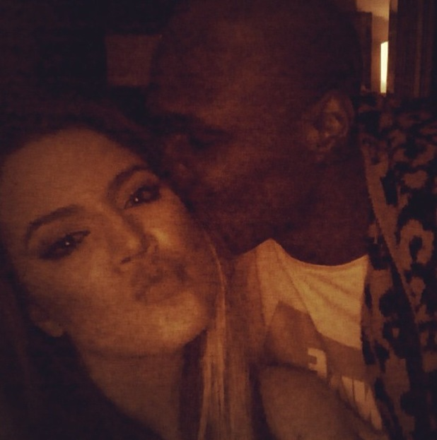 Khloe Kardashian and Lamar Odom kiss for the camera - 23 July 2013